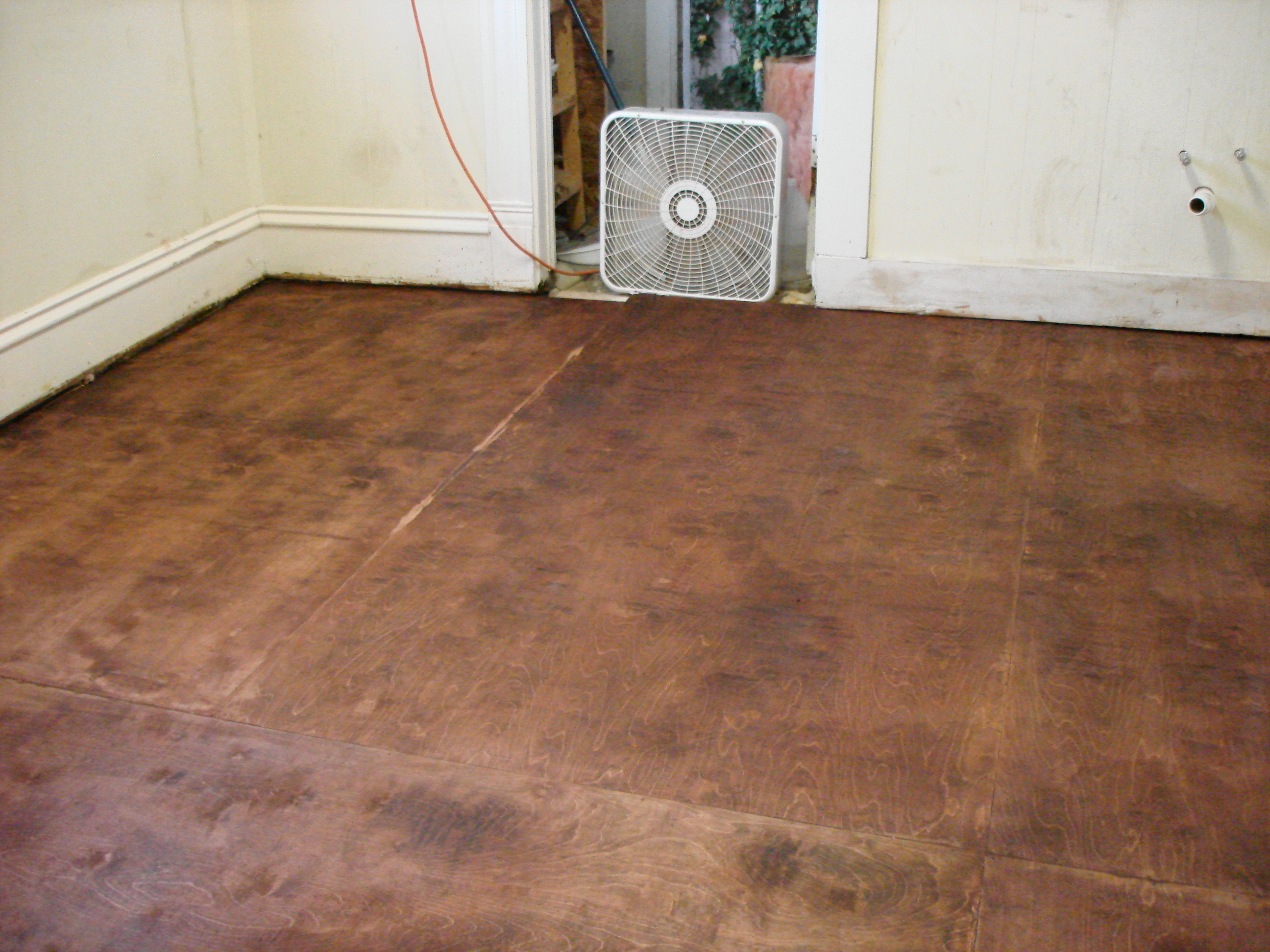 Paper beater and a new floor the alabama art kitchen for Homemade flooring ideas